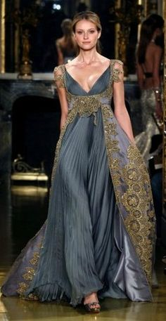 Zuhair Murad. I love the Georgian feel to the shape, and the medieval feel of the  heavy embellishments. quirky!