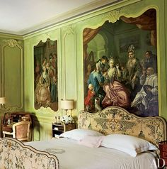 Decorated by Stephane Boudin in the 1950s, the Bishop's Room features antique paintings set within carved moldings, an embroidered bed, and a Louis XV leather-clad sofa. Northern Italian Estate of Marella Agnelli