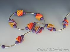 Necklace of extruded beads