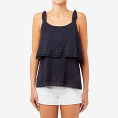 This lightweight tank is an easy and stylish piece to pair with shorts and skirts during the warmer months. Featuring tie up straps and a tiered design, it