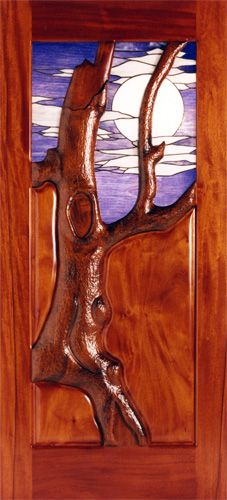 """""""Twilight Forest"""" by Fine Woodworks Custom Doors. This hand carved tree door is graced by a stained glass panel. Made of Hand-Carved Honduran Mahogany and Stained Glass. Visit our website for additional photos and pricing. Stained Glass Door, Custom Stained Glass, Stained Glass Panels, Entry Doors With Glass, Glass Doors, Rustic Doors, Wooden Doors, Tree Carving, Exterior Doors"""
