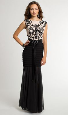 Skip the red and go black and nude for the holidays this year in a pretty two-tone tattoo lace formal dress. Whether you've been invited to a formal office holiday party, holiday gala, or a festive wedding celebration this timeless evening dress will be perfect for the occasion! The ornate bodice is beautiful and goes perfectly with the shutter pleat and chiffon skirt the flows stunningly to the floor. Wear this feminine gown to your next social event, shop now! •   Scoop neckline&#822...