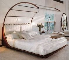 Bedroom , Having Lovable Nights with Your Couple By Selecting The Best Romantic Bedroom Colors : Romantic Bedroom In White For Holy Love Symbol With Uniqur Canopy Idea
