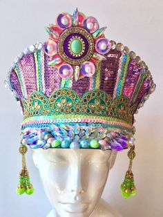 This beautiful Captains hat has been embellished with the most stunning pastel , holographic jewels and sequins. It catches the sun in a spectacular way , while channeling some serious holo unicorn vibes!  It is meticulously handcrafted and one of a kind  A sturdy hat that fits a regular sized adult head  The mannequin head is just a little more petite than a regular head  Ready to ship