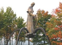 While in the Keweenaw area you will want to include a stop at the beautiful Bishop Baraga Shrine located just north of L'Anse. Erected in May, 1972, this religious historical monument commemorates the work of Bishop Frederick Baraga (1797-1868). The 35 foot, five ton hand wrought brass statue stands majestically amid the surrounding trees. Situated above the cliffs overlooking Keweenaw Bay, visitors find a peaceful spot to pause amid their travels while learning about the heroic life of Baraga.