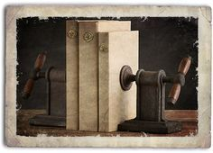"""Just stumble upon this webpage while busying myself with the mindless distraction of constructing a steam punk battle-staff. Check out the, """"Steampunk home industrial clamp bookends,"""" and other kickass curios on this site."""