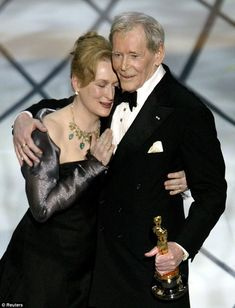 Actor Peter O'Toole is embraced by actress and presenter Meryl Streep after she presents him with his honorary Oscar