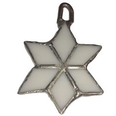 Carefully handmade from white glass and copper foil, this elegant snowflake ornament will look beautiful on your Christmas tree. The loop on top makes it easy to hang this lightweight ornament.