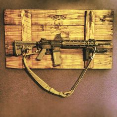Homemade gun rack for braydens hunting room Weapon Storage, Gun Storage, Paintball, Rifles, Rifle Rack, Gun Rooms, Guns And Ammo, Tactical Gear, Wood Pallets
