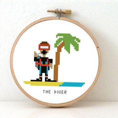 Make a DIY Gift for a DIVER with this Cross stitch pattern. You cant see who he is, but trust me he's a very handsome and cute guy! Perhaps even a dive instructor. Pattern designed by Studio Koekoek on Etsy