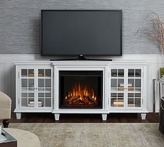Off white fireplace tv stand full size of harbour infrared electric fireplace entertainment center in white White Corner Electric Fireplace, Electric Fireplace Tv Stand, White Fireplace, Modern Fireplace, Electric Fireplaces, Fireplace Wall, Free Interior Design, Interior Design Services, Electric Fireplace Entertainment Center