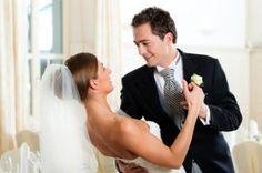 A groom dances with his bride.
