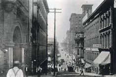 """This image looks down the hill at """"The Junction,"""" where Main and Delaware met Ninth Street. Somewhere below was """"Wide-Awake"""" Tuite, the traffic officer posted to keep pedestrians from being hit by the cable cars careening down the slope from Walnut, where the photo was taken. The narrow prow of Vaughn's Diamond, the landmark Second Empire-style flatiron commercial building that housed The KC Times, can be seen on the north side. Built in 1869, it was already old & would be torn down in…"""