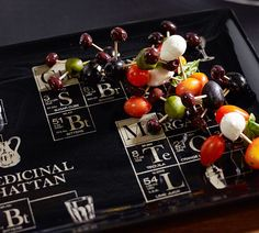 We love this quirky alternative to your average olive and cheese plate. Use toothpicks to attach cherry tomatoes, mozzarella balls, olives and basil in a molecular-model like display.