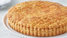 """Gateau Basque : Basque settlers first arrived in Nevada during the Gold Rush of the mid-1800s. Originally from the Pyrenees region of France, they brought with them a treasured recipe called gateau Basque, a tart that is traditionally filled with either pastry cream or black cherry jam. Martha's recipe combines the best of both worlds and calls for pastry cream and brandy-soaked cherries. She made this recipe on """"Martha Bakes"""" episode 710."""