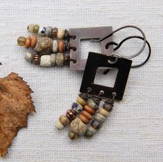 Rustic earrings: Flame-oxidized brass frames and by Sandelius