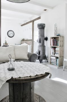 Mias Interiør.....another cool stove & cable spool table & crate bookcase....sigh