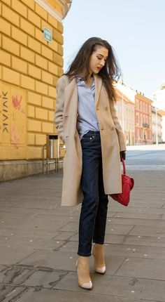 Fashion Blogger Veronika Lipar of Brunette from Wall Street dressed in dark A.P.C. tapered jeans, off white Weekend Max Mara coat, blue and white striped shirt, Gianvito Rossi plexi pumps, pink top handle bag from See by Chloe for work in spring