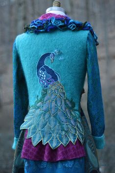Peacock sweater COAT. Amber studios #sweatercoat, #upcycledsweaters, #peacockcoat