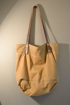 Wax cotton bag with leather straps and copper rivets. Made by myself.