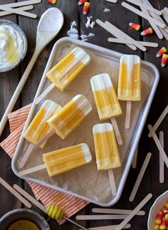Halloween Breakfast Popsicles: I love Halloween. I love dressing up, seeing all the costumes, and even partaking in some of the holiday sweets. And I'm not a big sweets person… except when it comes to candy corn. I need diabetes-inducing levels of candy corn! So why not candy corn for breakfast? Well, because that's gross. But this Halloween Breakfast Popsicle is not. Made with Greek yogurt and fresh mangos, give your day a healthy start that is both festive and tasty.
