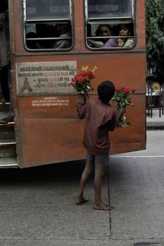 Young Boy Selling Flowers, India, (1993)