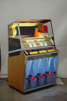 With 200 possible songs to choose from the 1957 Seeburg Select-O-Matic KD-200 Jukebox can really help you cut a rug!