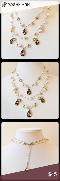 Betsey Johnson Leopard Pearls Illusion Necklace Teardrop leopard print charms, faux pearls, crystals and gold tone flowers hang from three golden strands. 'Like new' condition. Very pretty! Betsey Johnson Jewelry Necklaces