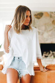 White pom pom loose flowy top + light denim shorts