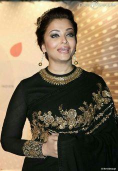 Beauty queen in Black with golden work.