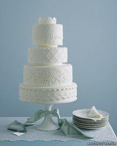 This eyelet sampler fromWendy Kromer—with its cutouts, flowers, and pristine whiteness—evokes summer as prettily as a billowing cotton dress. Each fondant-covered tier presents a different eyelet.