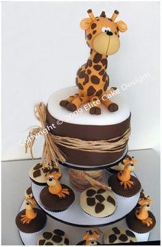 Giraffe birthday cutting cake and 'matching' cupcakes