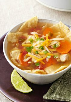 Slow-Cooker Chicken Tortilla Soup – Cheese tops bowls of chicken tortilla soup that literally cooks itself in a slow cooker. Enjoy your time away from the stove!