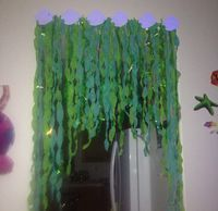Seaweed decor for under the sea party made of streamer and tissue paper!