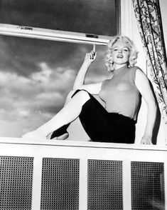 Marilyn in her suite at the Banff Springs Hotel during the filming of River of No Return, 1953.
