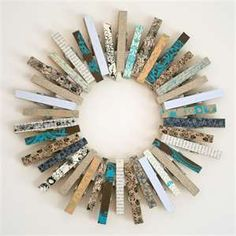 Decorate clothes pins with washi tape and make wreath for door