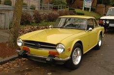 Triumph TR6 (1974).......going to cry.  Clone of my baby.