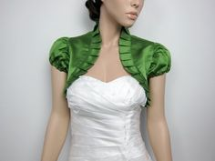 Moss Green sleeve wedding satin bolero jacket-This is a moss green puff short sleeve satin bolero jacket made of bridal satin with ruffled edges. Small size normally fits US size size normally fits US size size normally fits US s Bridal Bolero, Lace Bolero, Bolero Jacket, Jacket Dress, Wedding Bolero, Sleeves Designs For Dresses, Wedding Jacket, Red Shorts, Blouse Designs