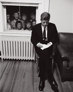 1960 John F Kennedy sat down while voters looking through window. [786x1000] : HistoryPorn