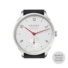 NOMOS Glashutte Minimatik timepiece is presented on a black leather strap. The case encases a white dial with numeral hour markers and red hands. This watch features a NOMOS calibre DUW 3001 automatic movement with a 43 hour power reserve. Glashutte Original, Cyan Blue, Red Dot Design, Automatic Watches For Men, Watch Faces, Blue Accents, Beautiful Watches, Contemporary Jewellery, Gnomes