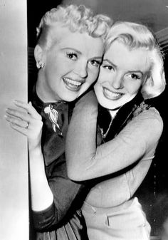 20th Century-Fox beauties Betty Grable and Marilyn Monroe