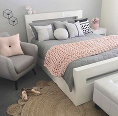 Grey, white and pink toned bedroom design with a beachy vibe