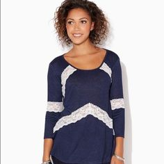 """JoyceAnne lace top A cute navy top with lace v inserts from charming Charlie. Very gently used and great for everyday. Rayon/Poly makes it super soft and gives it a nice drape. No signs of wear, probably worn a couple of times. Bust 19"""" length 27"""". S Charming Charlie Tops"""