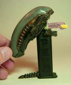 I went to LV-426 and all I got was this Pez dispenser :)  Worth it!  This fun / nerdy toy is a candy repository of doom, shaped like one of the homicidal critters (aka a xenomorph) from Ridley Scott's Alien movie (and book and graphic novel etc. etc.) franchise.  For those who want their sweets with a side of sci fi horror, take the candy from the inner mouth, and don't bother running, you'll only die tired :)