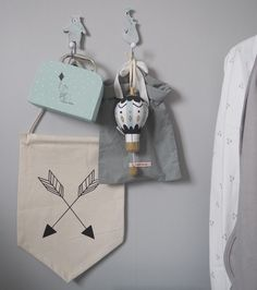 ferm LIVING Arrow Flag: http://www.fermliving.com/webshop/shop/kids-room/kids-objects/arrow-wall-flag.aspx