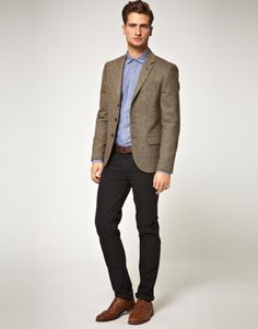 Attire for the office. Keep the jeans simple, couple with a tweed jacket to dress up the demin.