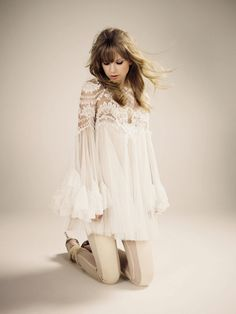 That pose with the hair flying just so. I also love the dress! Taylor Swift photo shoot.