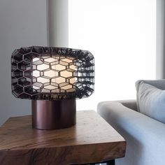 The Honeycomb LED Table Lamp is handmade in the Philippines from galvanized iron, a malleable material which allows artisans to weave innovative shapes.