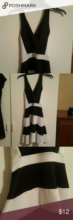 Black & White Halter Top Dress Black & White Stripes, Halter Top with open back, worn once! Charlotte Russe Dresses