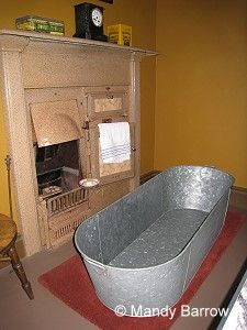 Tin Bath Poorer families, if they owned a bath at all, put it in front of the kitchen rang. This was the warmest place in the house and very close to hot water. The whole family would wash themselves one after the other, topping up with more water but, probably not emptying the bath until everyone had finished.
